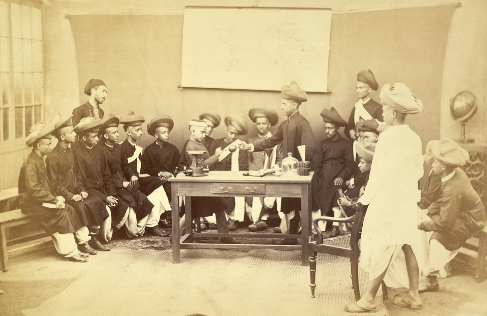Photograph of Maratha? pupils in a Science class of the Elphinstone High School at Bombay, from the Archaeological Survey of India Collections: India Office Series (Volume 46), taken by an unknown photographer in c. 1873